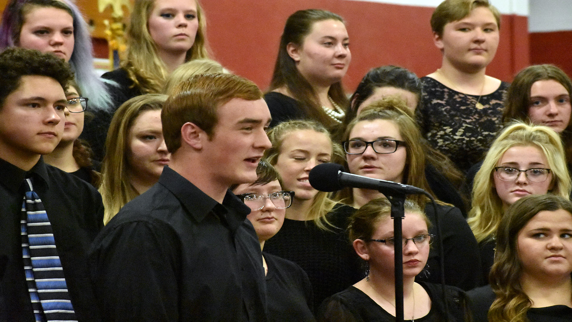 Tate Erickson and the rest of the choir perform at the Veteran's Day Assembly. | Photo by Cambry Smith