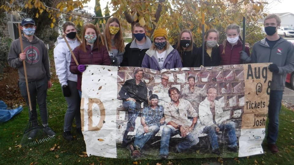 Members of the Kimberly Key Club pose during a leaf raking service project. | Photo by unknown