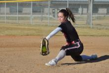 Macee Cook scoops up a ball during a game this season. | Photo by Journee Stewart
